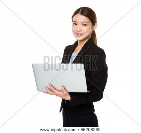 Young asian businesswoman using laptop computer