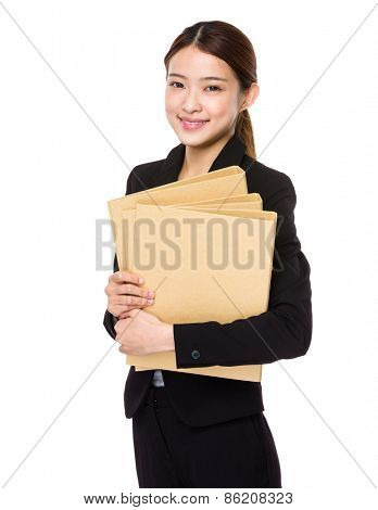 Young business woman holding report