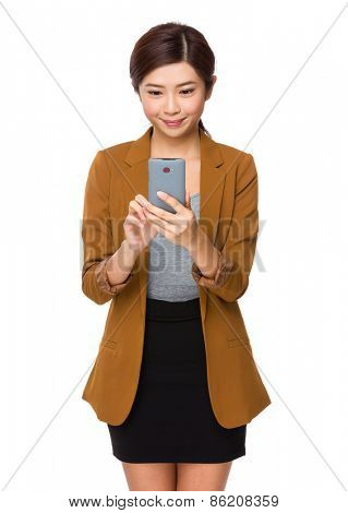 Thinking Japanese businesswoman with the smartphone