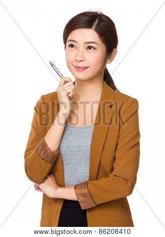 Businesswoman with a pen in her hand