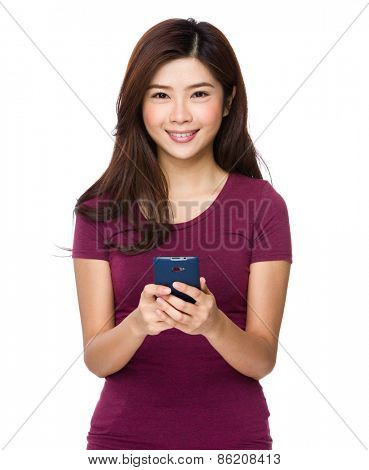 Chinese woman texting with cell phone