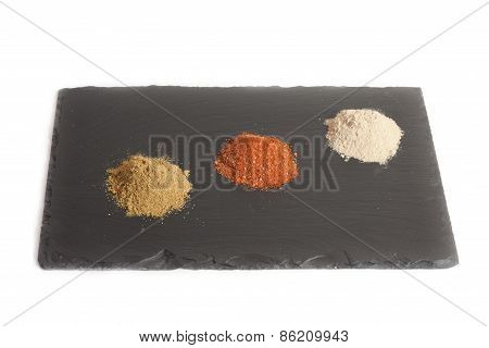 three different types of spices from India, on a plate