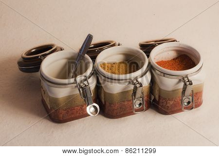 three pots of indian spices, Indian kitchen