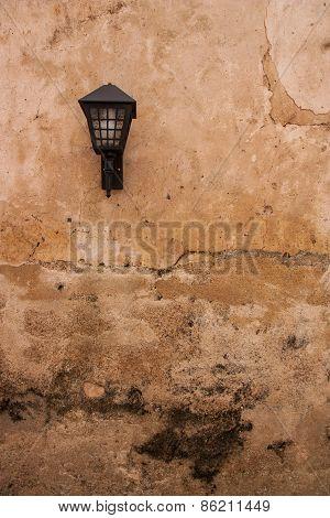 Vintage Lamp On Old Plaster Walls.