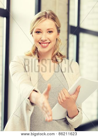 lovely woman with an open hand ready for handshake