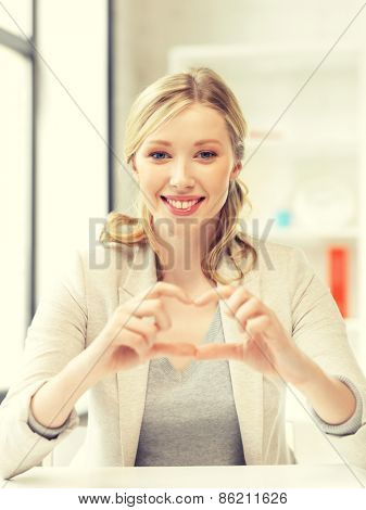 bright picture of young woman showing heart sign