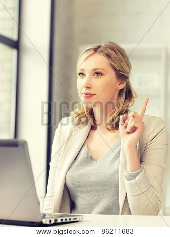 woman with laptop computer and finger up