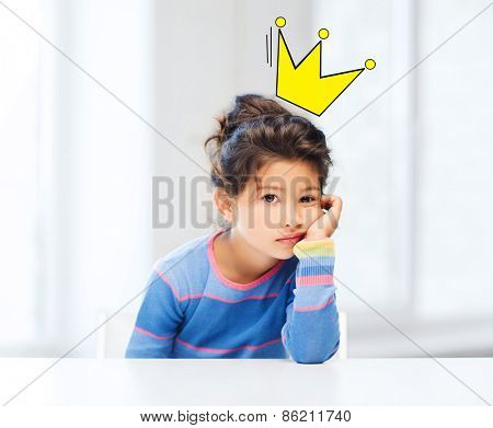 people, childhood and emotions concept - sad or bored little girl over living room background and crown doodle