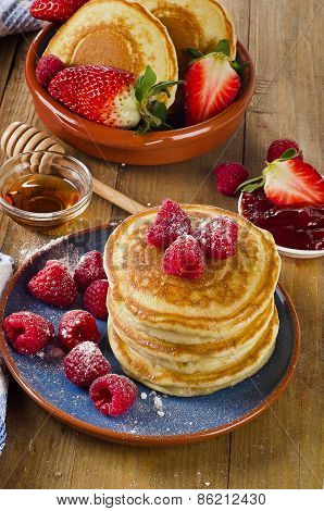 Small Pancakes With Berries And Syrup.