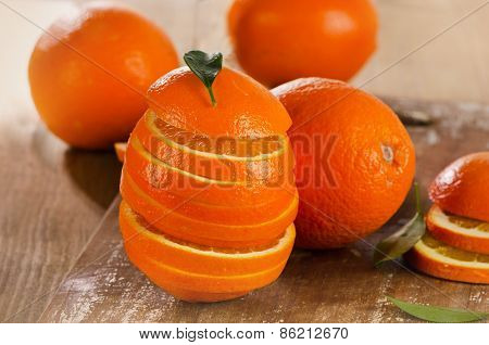 Stack Of Orange Slices On  Wooden Table.
