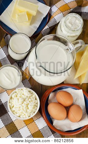 Dairy Products On A Wooden Table