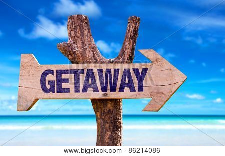 Getaway sign with a beach on background