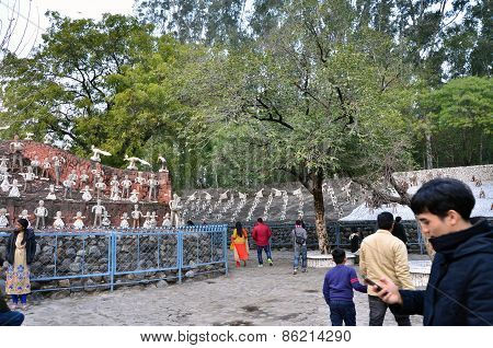 Chandigarh, India - January 4, 2015: Tourist Visit Rock Statues At The Rock Garden In Chandigarh