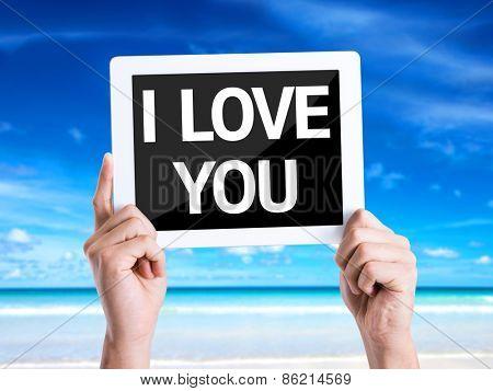 Tablet pc with text I Love You with beach background