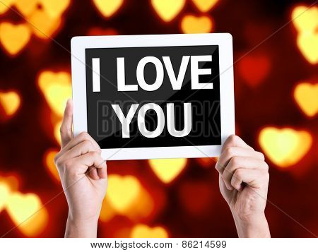 Tablet pc with text I Love You with heart bokeh