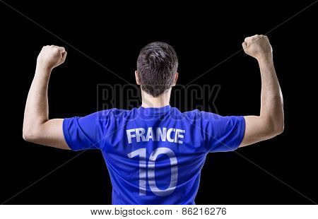 French soccer player celebrating on black background