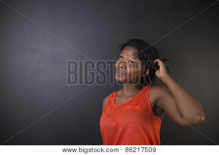 South African Or African American Woman Teacher Thinking On Black Background