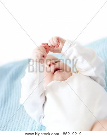 baby watching at own fingers