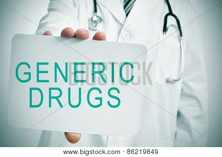 closeup of a young caucasian doctor showing a signboard with the text generic drugs written in it
