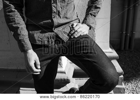 Lower Body Of Men Dressed In Selvedge Jeans And Plaid Shirt.