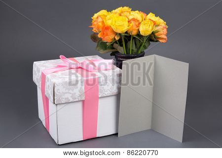 Blank Gift Card, Bouquet Of Rose Flowers And Gift Box Over Grey