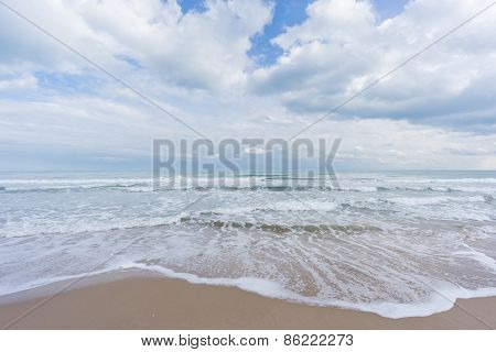 Beach, sand with sea and clouds