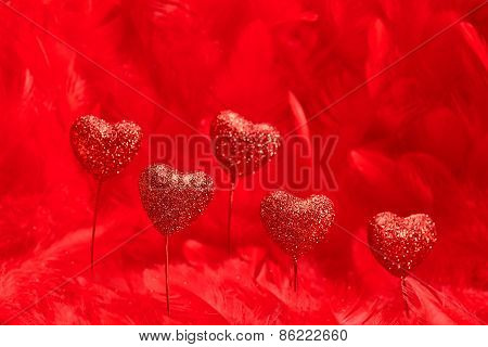 Valentines Day. Hearts Red Sparkling On Feathers Background. Love Concept