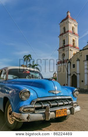 Classic blue Chevrolet Parked In The Central Square In Remedios