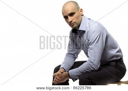 Image of sitting hairless business man