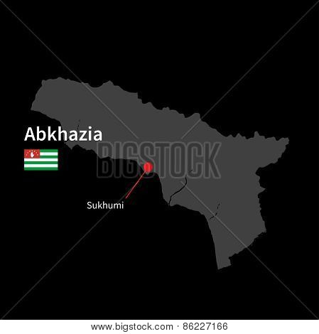 Detailed map of Abkhazia and capital city Sukhumi with flag on black background