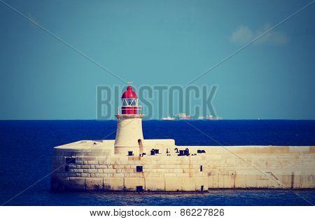 Lighthouse on Malta, Mediterranean sea, toned image