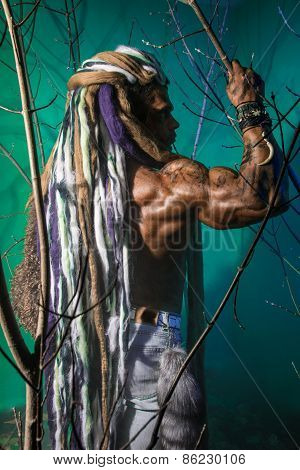 Muscular Man In Profile With Dreadlocks In The Forest
