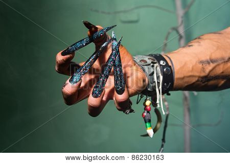 Man's Hand With Long Nails Out Of A Nightmare