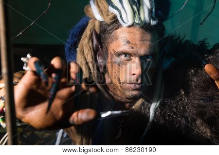 Close-up Portrait Of A Man With Dreadlocks In The Skin