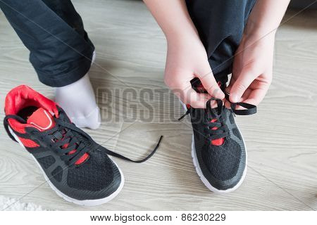 The boy running shoes  laces