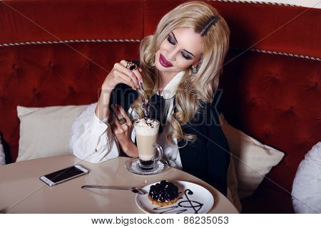 Gorgeous Woman With Blond Hair Sitting In Cafe With Coffee And Dessert