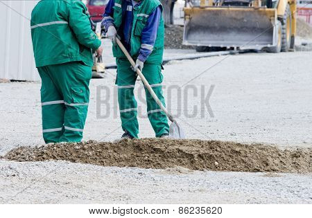 Workers With Shovel