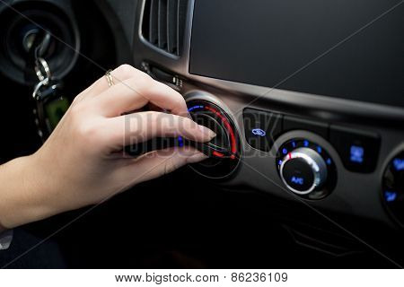 Woman Adjusting Car Conditioner Temperature