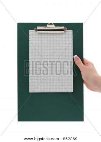 female hand holding a clipboard with squared paper page