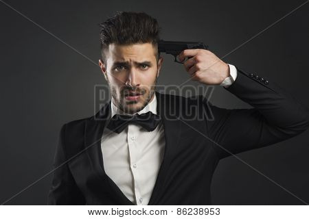 Stressed businessman giving a gunshot on his own head