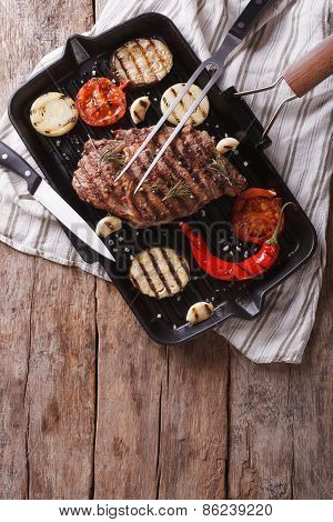 Grilled Beef Steak With Vegetables In Pan. Vertical Top View