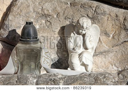 ZAGREB, CROATIA - OCTOBER 28: A white mourning porcelain angel on a Mirogoj cemetery in Zagreb, Croatia on October 28, 2013.