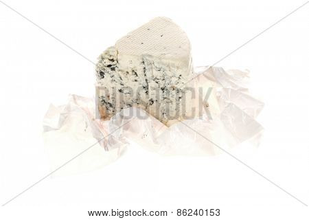 aged italian deli fresh blue stilton cheese in wrapping paper isolated over white background