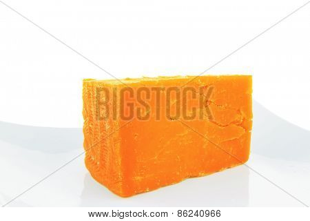 french gourmet dark cheddar cheese served on a ceramic plate isolated over white background