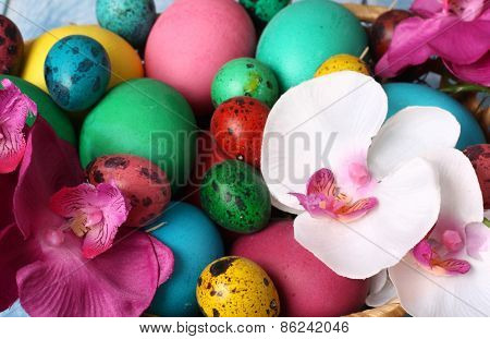 colorful Easter eggs on a blue table