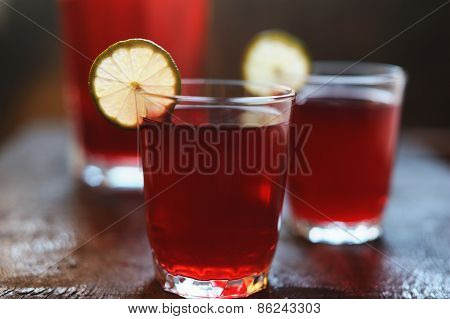Red Lemonade With Lime Slices