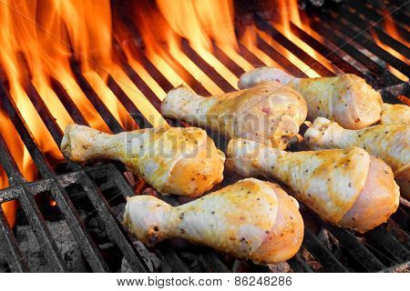 ?hicken Legs On The Hot Flaming Barbecue Grill