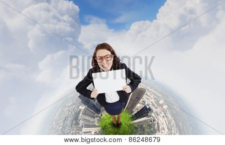 Top view of excited businesswoman holding white blank banner. Place for text