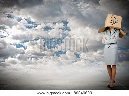 Businesswoman wearing carton box with sign on head