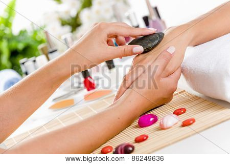 Close up of process of hand massage at beauty salon